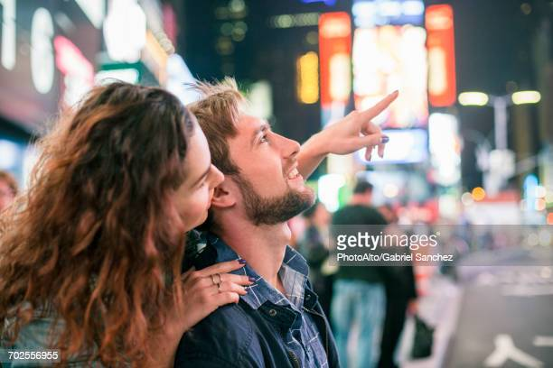 Young couple sightseeing in Times Square, New York City, New York, USA