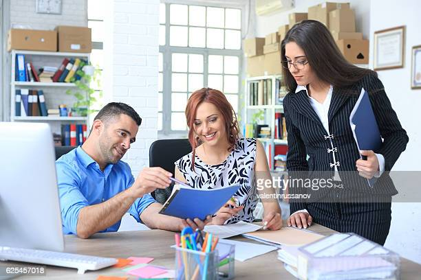 Young couple signing agreement with agent