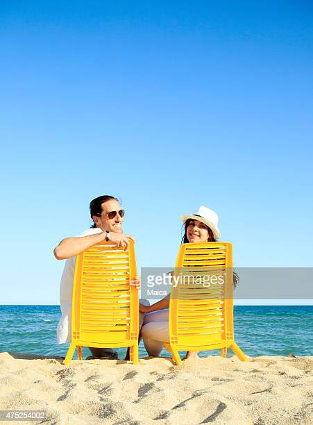 Young couple sitting a  the seashore