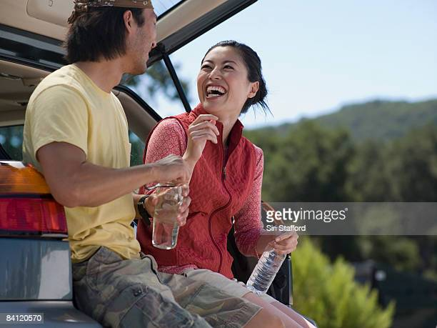 Young couple sitting and laughing