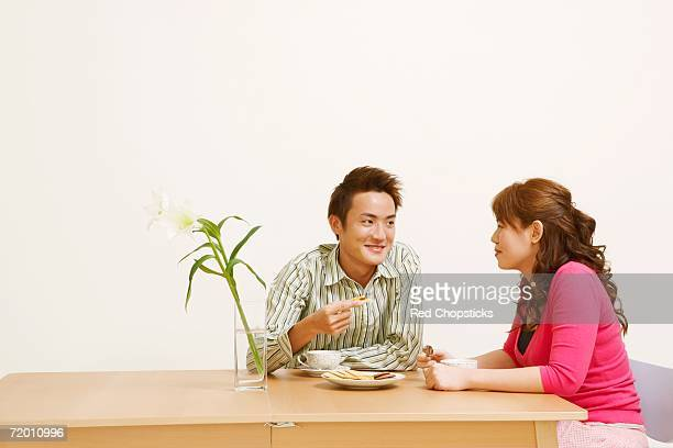 Young couple sitting and looking at each other
