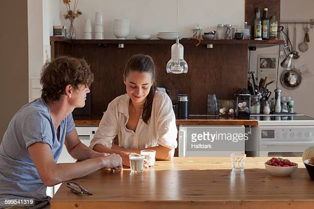 Young couple sitting at dining table