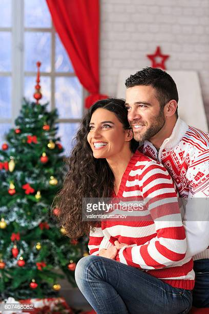 Young couple sitting at home for christmas
