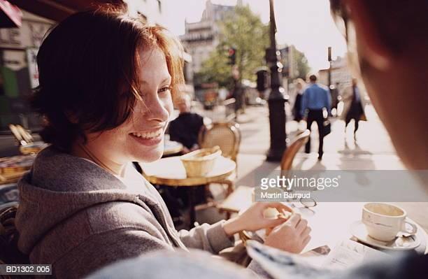 young couple sitting at outdoor cafe, close-up, paris, france - terrasse de café photos et images de collection
