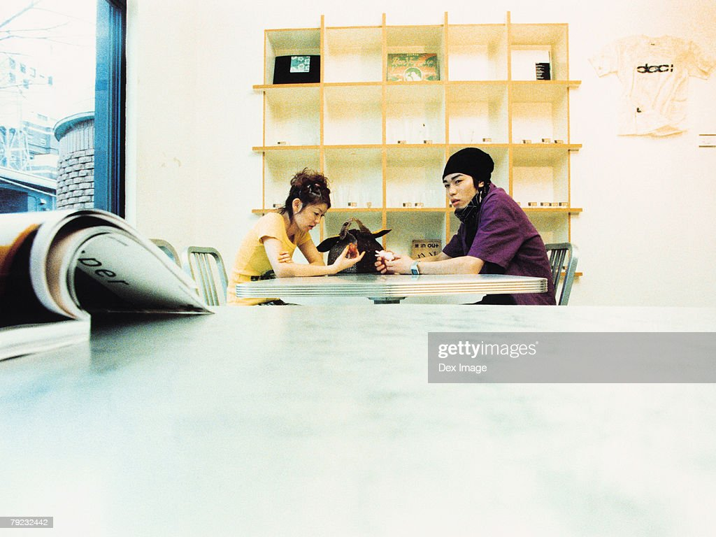 Young couple sitting at table : Stock Photo