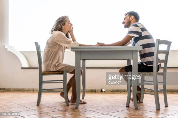 Young couple sitting at the table