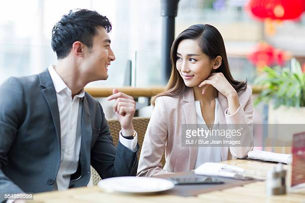 Young couple sitting in restaurant