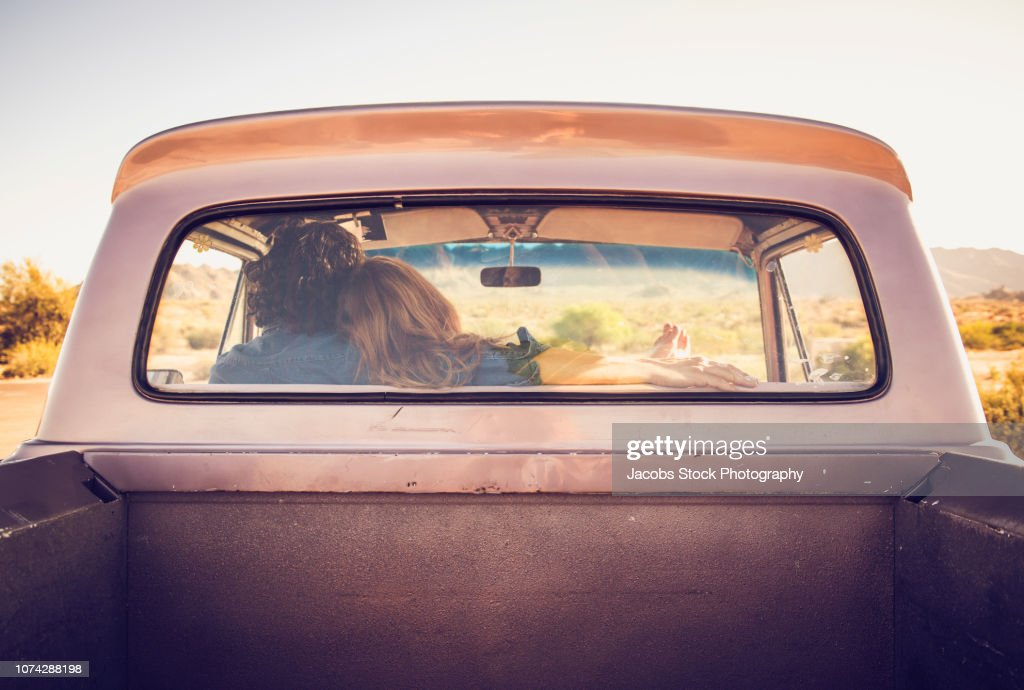 Young Couple Sitting In Vintage Pickup Truck High Res Stock Photo Getty Images