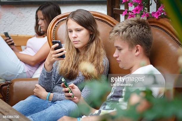 Young couple sitting on a couch staying outside in the garden on August 10 2015 in Bonn Germany