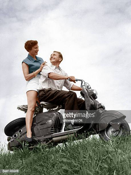A young couple sitting on a motor scooter in the country 1954 digitally colorized original image no 72640 No_use_for_cover_until31509