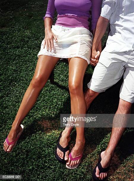 young couple sitting on chairs on lawn, elevated view - legs and short skirt sitting down stock pictures, royalty-free photos & images