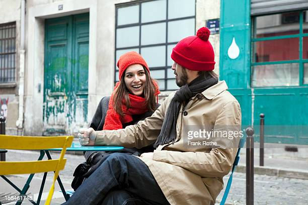 young couple sitting outside a restaurant