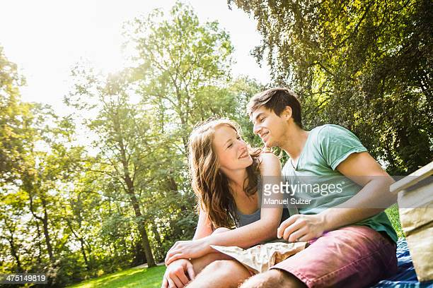 Young couple sitting together in park