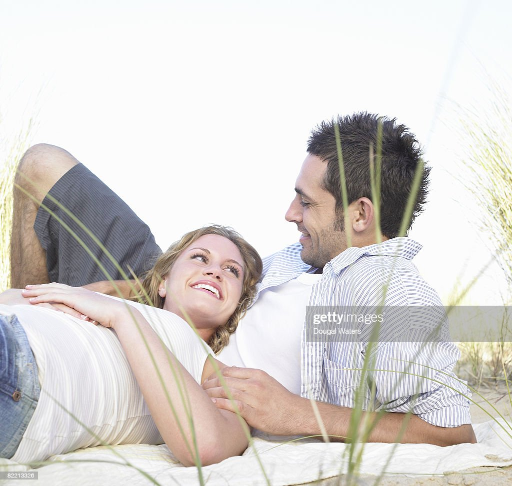 Young couple sitting together : Stock Photo