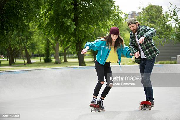 Young couple skateboarding