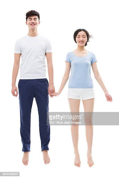 Young couple sleeping in mid-air