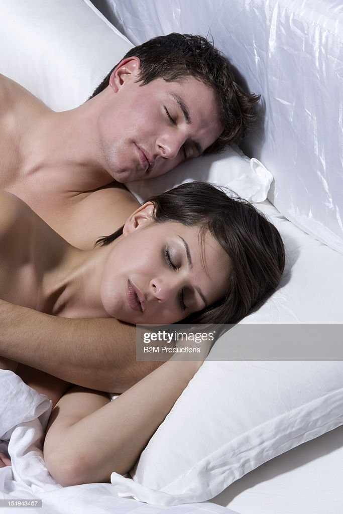 Young Couple Sleeping On Bed : Stock Photo
