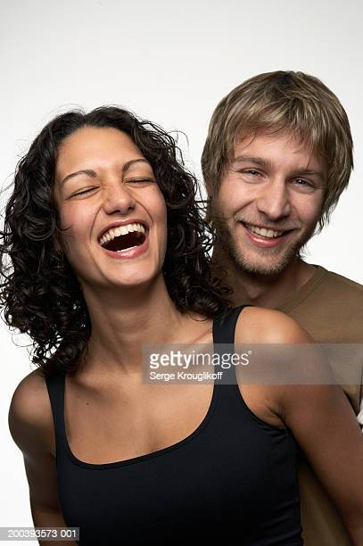 young couple smiling and laughing, woman with eyes closed, portrait - casal heterossexual - fotografias e filmes do acervo