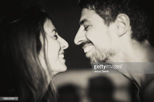 young couple smiling at each other, close up - silhueta de corpo feminino preto e branco imagens e fotografias de stock