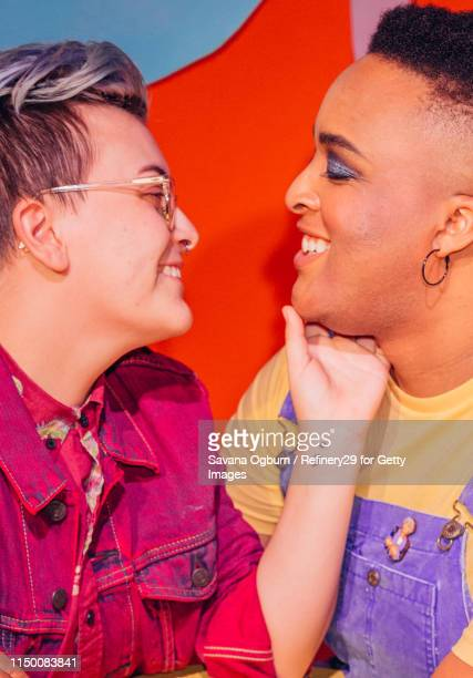 young couple smiling at each other - transgender stock-fotos und bilder