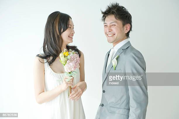Young couple smiling face to face