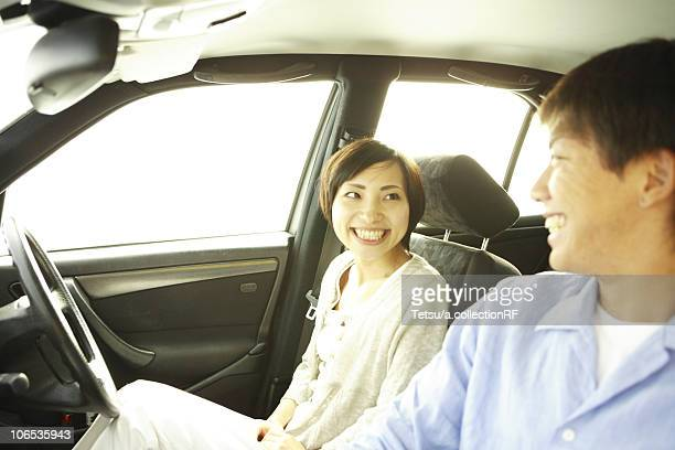 Young Couple Smiling in the Car