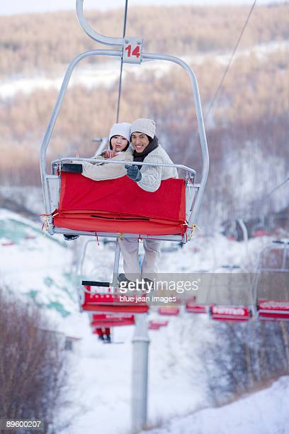 Young couple smiling on a ski lift