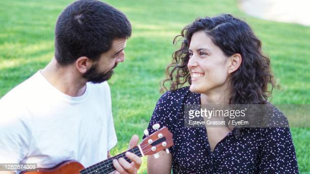 young couple smiling - modern rock stock pictures, royalty-free photos & images