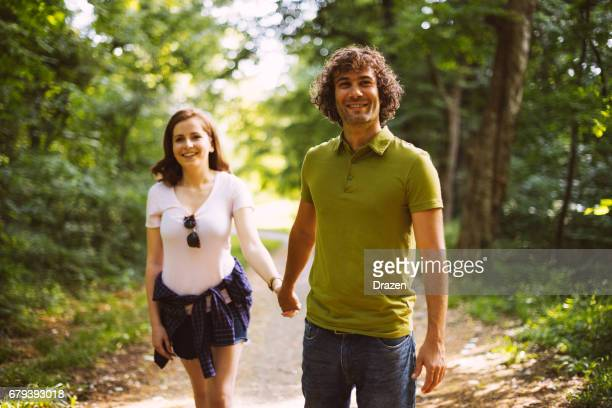 Young couple spending time together in nature on hot summer day