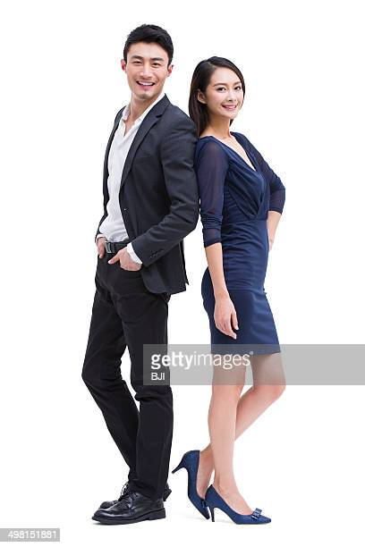young couple standing back to back - 背中合わせ ストックフォトと画像