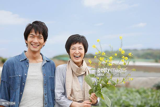 Young couple standing in field