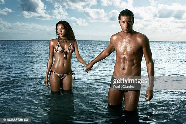 Young couple standing in sea