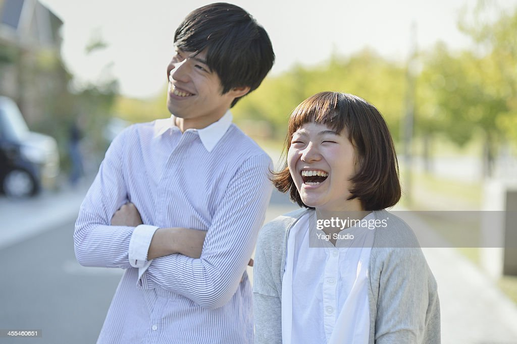 Young couple standing in the residential area : Stock Photo