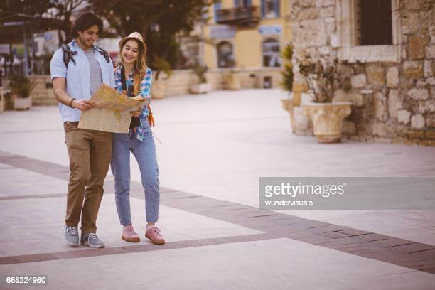 Young couple standing in the streets of an old town