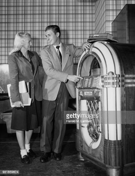 Young couple standing near jukebox