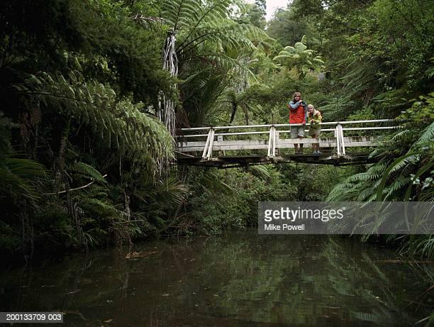 Young couple standing on bridge