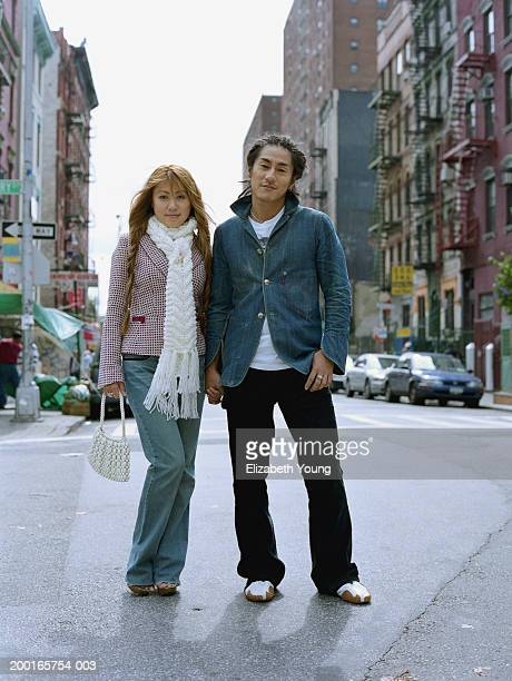 Young couple standing on city street