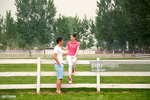 Young Couple Standing on Grassland