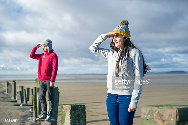 young couple standing on groynes, brean sands, somerset, england - sean malyon stock pictures, royalty-free photos & images