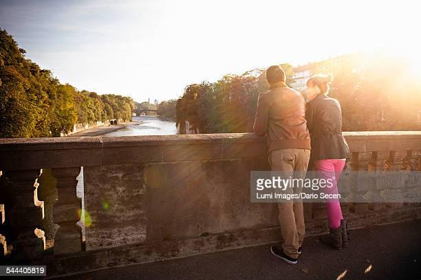 Young couple standing on Luitpoldbrcke, Munich, Bavaria, Germany