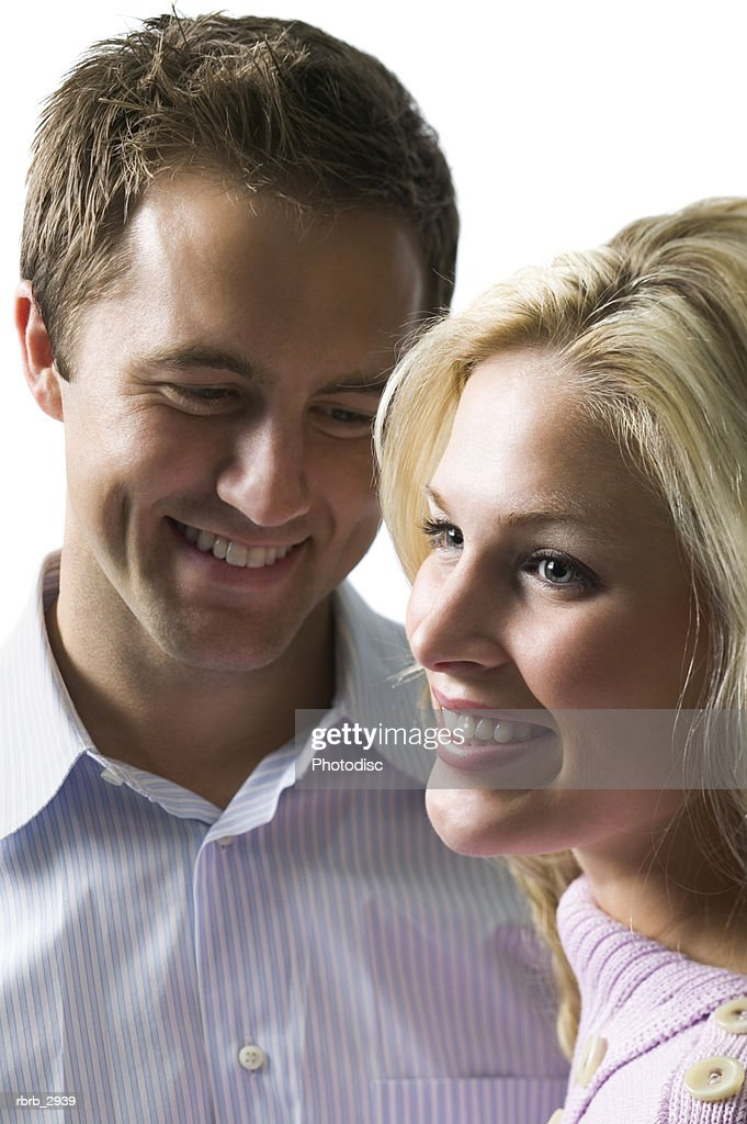 Young couple standing together smiling : Foto de stock