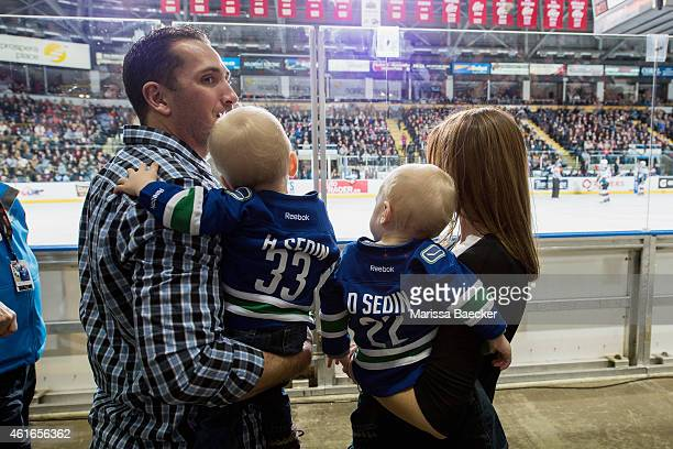A young couple stands at the glass during second period intermission with the Sedin twins as the Kelowna Rockets host the Seattle Thunderbirds on...