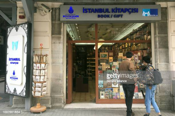 A young couple stands in front of the city's book shop on the central Istiklal Street in Istanbul Turkey 16 May 2017 After publishing a critical...
