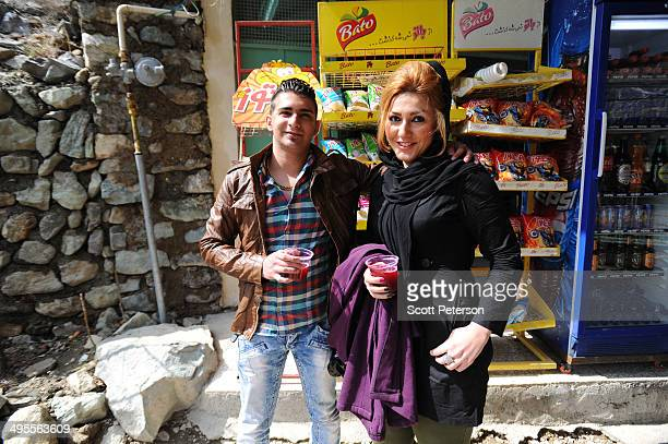 A young couple stop for juice as Iranian hikers visit the Darakeh area on the northwest edge of the capital in the foothills of the Alborz Mountains...