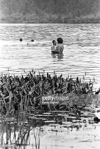 A young couple swim naked in the lake at the Woodstock Music Art Fair Bethel NY August 15 1969