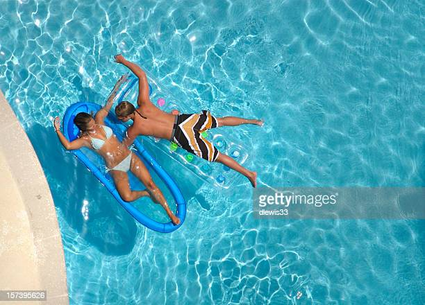 Young Couple Swimming on Vacation