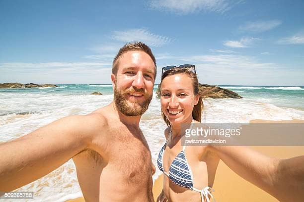 Young couple take a selfie portrait on the beach