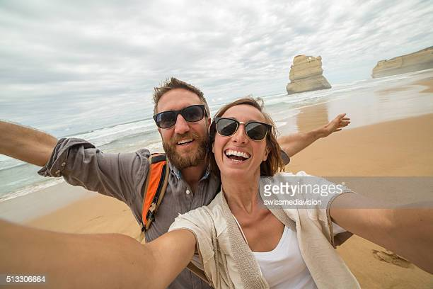 Young couple take selfie on Gibsons steps beach-Great ocean road