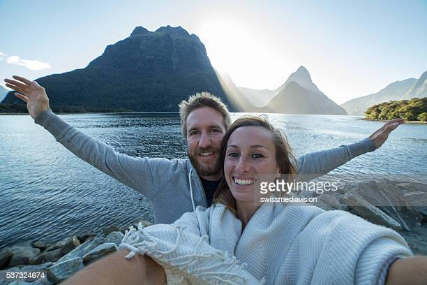Young couple take selfie portrait in Milford sound, NZ