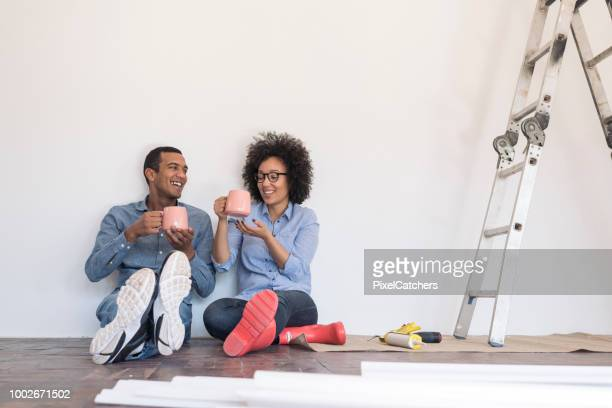 Young couple taking a break from DIY